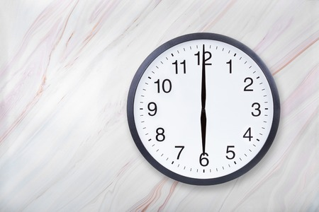 Photo for Wall clock show six oclock on marble texture. Office clock show 6pm or 6am on marble texture with natural pattern - Royalty Free Image