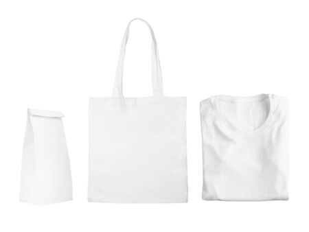 Photo for Collection of white objects isolated on white background. White cotton bag, white folded t-shirt, paper bag package. Flat lay of branding or identity mockup design. - Royalty Free Image
