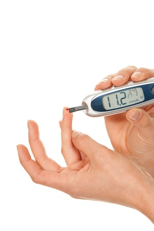 Diabet patient measuring glucose level blood using glucometer test isolated on a white background. High blood sugar hyperglycemia