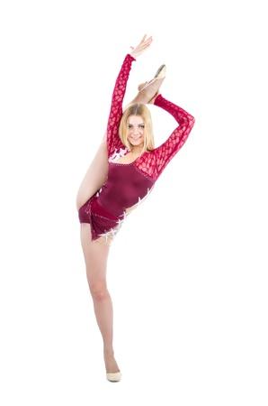 Slim flexible woman rhythmic gymnastics art dancer stand on splits isolated on a white background