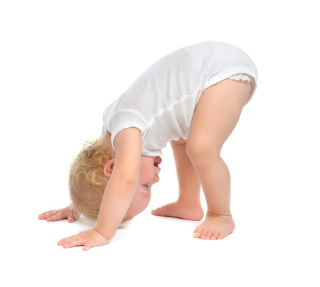 Infant child baby toddler happy smiling with hand and trying to tumble isolated on a white background