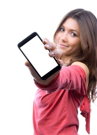 Young woman show display of mobile cell phone with blank screen and smiling on a white background. Focus on hand with mobile phone