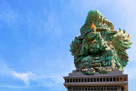 Photo pour Landscape picture of old Garuda Wisnu Kencana GWK statue as  Bali landmark with blue sky as a background. Balinese traditional symbol of hindu religion. Popular travel destinations in Indonesia. - image libre de droit