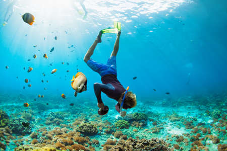 Photo pour Happy family vacation. Man in snorkeling mask with camera dive underwater with tropical fishes in coral reef sea pool. Travel lifestyle, water sport outdoor adventure, swimming on summer beach holiday. - image libre de droit