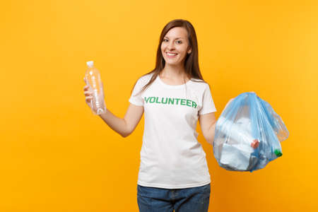 Photo for Woman in t-shirt volunteer, trash bag isolated on yellow background. Voluntary free assistance help, charity grace. Environmental pollution problem. Stop nature garbage environment protection concept - Royalty Free Image