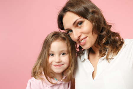 Photo for Close up selfie shot woman in light clothes have fun with cute child baby girl. Mother, little kid daughter isolated on pastel pink wall background, studio portrait. Mother's Day, love family concept - Royalty Free Image