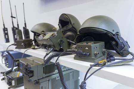 Photo for Military helmet and electronics at the exhibition. Weapons - Royalty Free Image