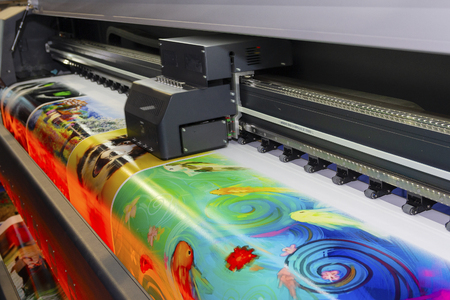 Foto de Large format printing machine in operation. Industry - Imagen libre de derechos
