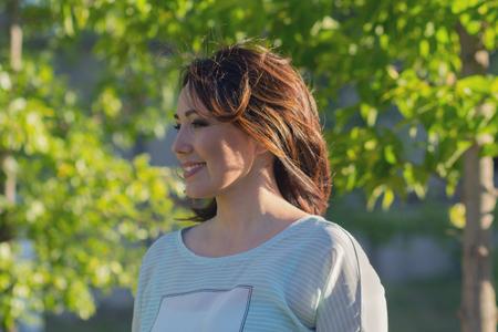 Foto de Happy beautiful woman in the garden. People - Imagen libre de derechos