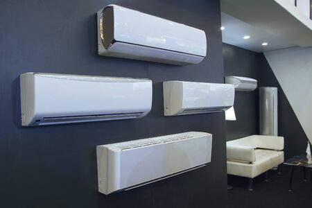 Photo for Air conditioner in a row for sale in a shop during summer hot season - Royalty Free Image