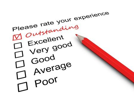 Photo for Survey form with a tick placed in Outstanding checkbox. - Royalty Free Image