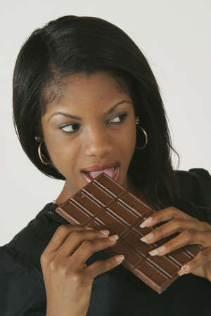 Model Release #278  African American Woman in early 20's eating junk food