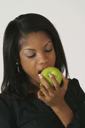 Model Release #278  African American Woman in early 20's eating apple