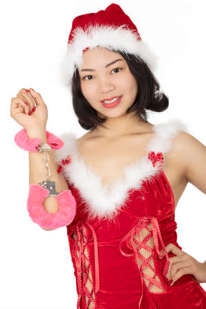 Photo pour Beautiful Chinese woman dressed as a sexy Santa isolated on a white background - image libre de droit