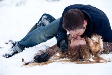 Photo for lovers being passionate lying in the snow - Royalty Free Image
