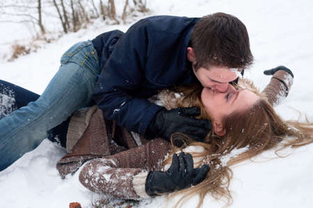 couple making out in the snow