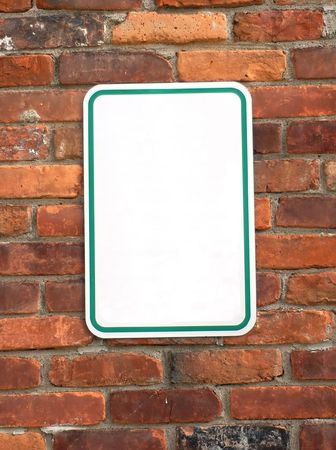 Blank sign on a brick wall ready to put your text