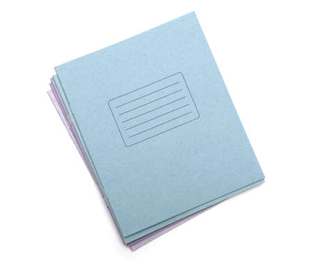 multicolored exercise books over the white background