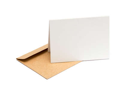 Photo for brown envelope with a blank white card over white - Royalty Free Image