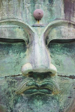 Close up of the bronze Buddha in Kamakura