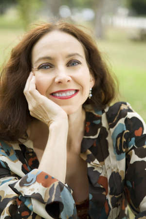 Portrait of a middle age woman smiling in the park