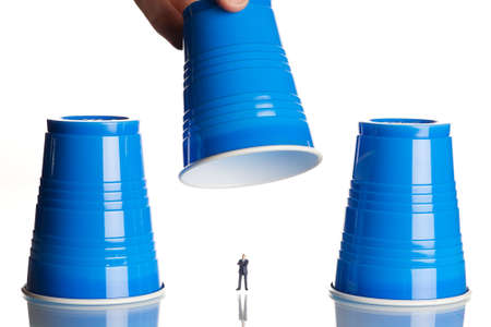 business figurines placed under plastic coffee cups