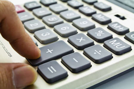 Business growing, a finger press on the adding button on calculator