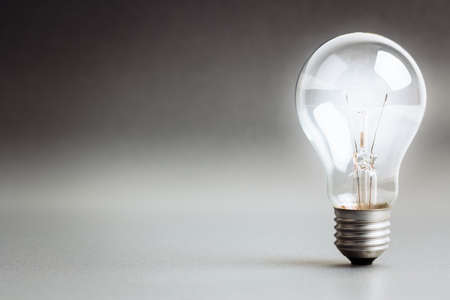 Photo for Light bulb glowing white light - Royalty Free Image