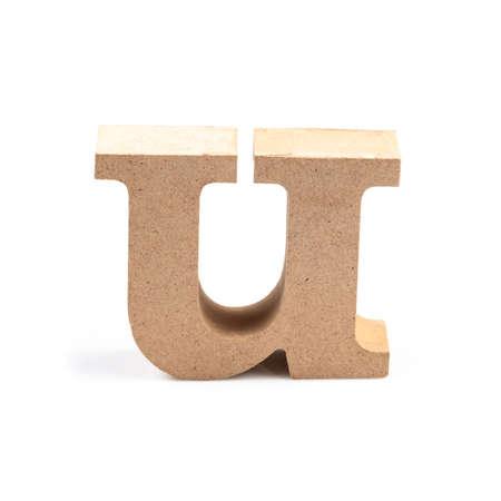 Foto de The wooden alphabet U in lower case font isolated on white - Imagen libre de derechos