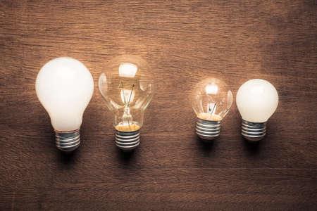 Photo pour Different style and size of light bulbs in comparison concept - image libre de droit