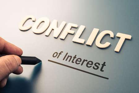 Foto de Conflict of Interest, hand writing text attach the letters word to complete concept - Imagen libre de derechos