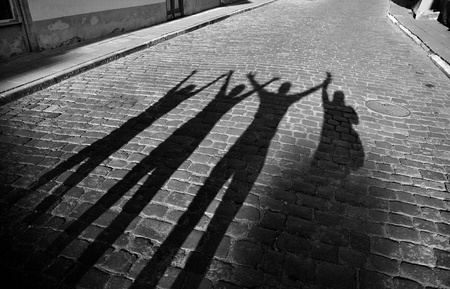 Four shadows jump on roadway