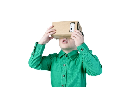 Photo pour Little child uses virtual reality (VR cardboard) isolated on white background - image libre de droit