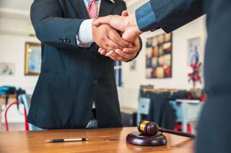 Foto de Lawyers and businessmen join hands in business After signing the legal consultancy contract - Imagen libre de derechos