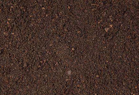 Photo pour Background with brown dry soil. Pitchfork on top. A concept for your design. - image libre de droit