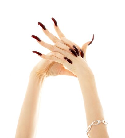 hands with long acrylic nails over white