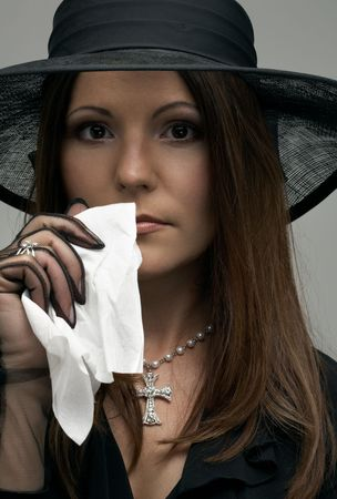 crying christian lady in black funeral dress