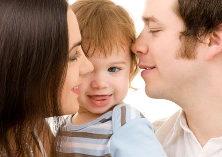 bright picture of happy family over white (focus on baby)の写真素材
