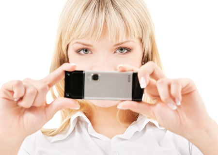 picture of happy woman using phone cameraの写真素材