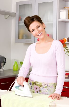 picture of ironing woman in the kitchen