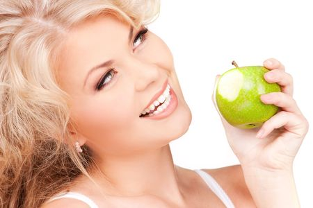 picture of young beautiful woman with green appleの写真素材