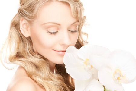 picture of beautiful woman with white flowerの写真素材