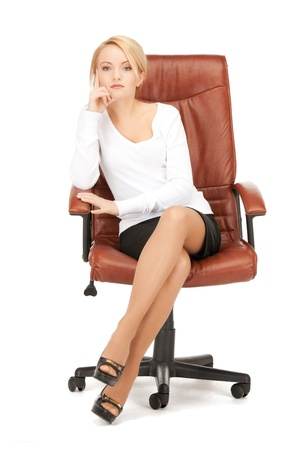 picture of young businesswoman sitting in chair