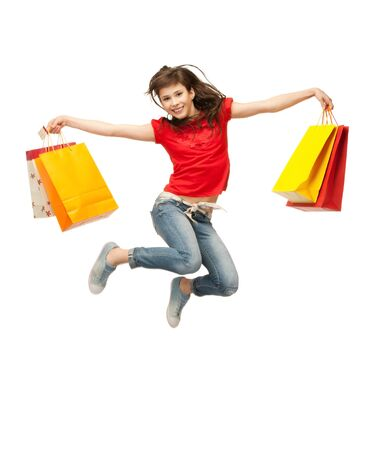 picture of jumping teenage girl with shopping bagsの写真素材