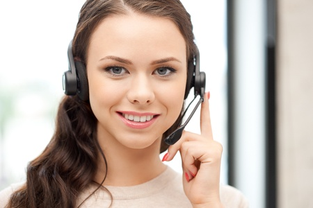 bright picture of friendly female helpline operatorの写真素材