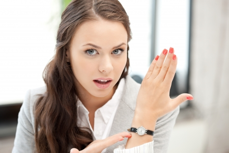 bright picture of attractive businesswoman with watch