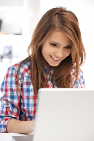 picture of happy woman with laptop computerの写真素材