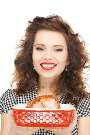 bright picture of lovely housewife with meat.の写真素材