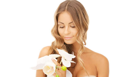 picture of beautiful woman with orchid flowerの写真素材
