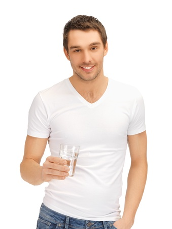Photo pour handsome man in white shirt with glass of water - image libre de droit